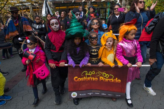 Children parade around the Bronx Zoo for the annual Boo at the Zoo Costume Parade in 2018.