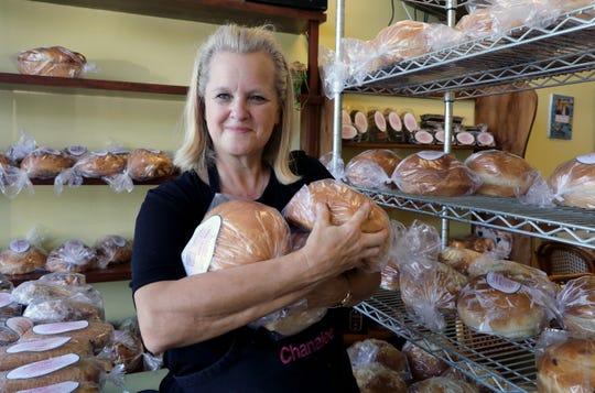 Chanalee Fischer Schlisser, the owner of The Challah Fairy in New City, is pictured with a variety of her challah Sept. 20, 2019.