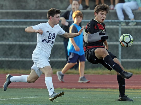 Rye's Connor Camacho (33) and Byram Hills' Ross Eagle (29) battle for control of the ball during boys soccer game at Rye High School Sept.19, 2019. Byram Hills defeats Rye 1-0.