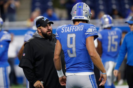Detroit Lions head coach Matt Patricia talks with quarterback Matthew Stafford before an NFL football game against the Los Angeles Chargers in Detroit, Sunday, Sept. 15, 2019. (AP Photo/Rick Osentoski)