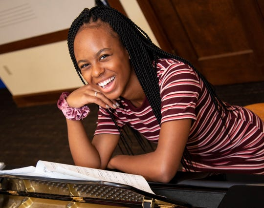 A student in the Upper School studies music.