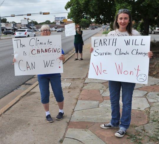 From left: Joy Parsons, Rusty Maley, and Leslie Spencer participate in the global climate strike Friday morning at the Wichita County Democratic Headquarters located on Kemp Blvd.