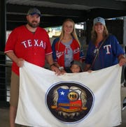 Wichita Falls police officer Tim Putney, far left, his daughter Abby, center, son, Myles, bottom center, and wife Chelsea at a Peace Officers' Angels Foundation event during a Texas Rangers game at the Globe Life Park in Arlington Sept. 13.