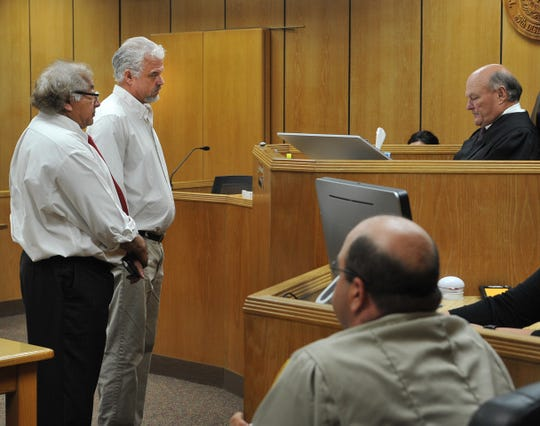Charles Lanar Monkres Jr. stood next to his attorney Robert Estrada after he pleaded guilty, Thursday afternoon in the 89th district courtroom, to charges of theft of brass.