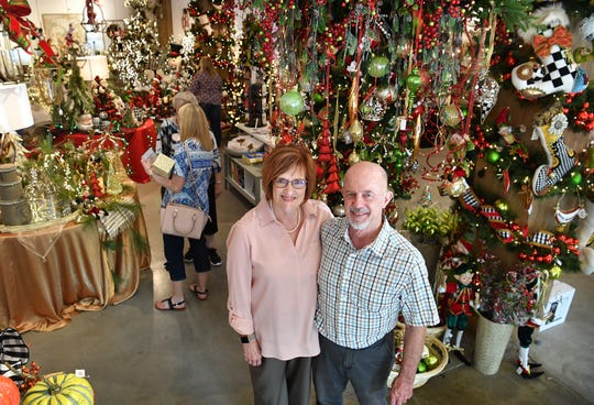 Cheryl and John Beer, owners of Encore, a year-round store for Christmas decorations, held the grand opening Thursday.