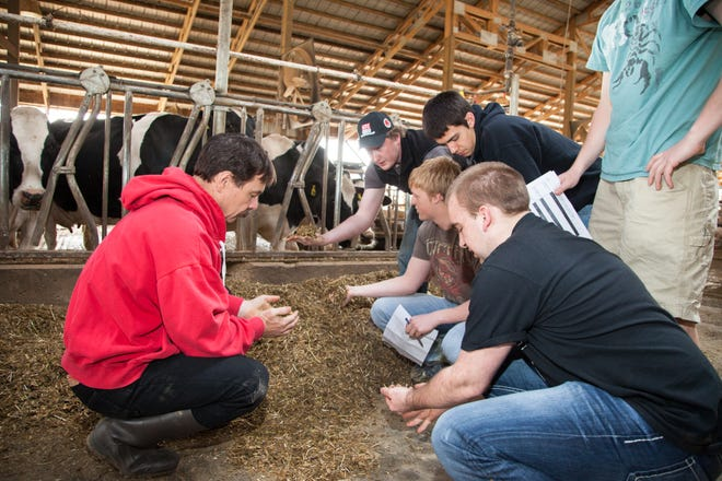Dr. Randy Shaver is pictured, left, in this April 22, 2013 photo during a dairy science student field trip to SunBurst Dairy, Belleville, WI.