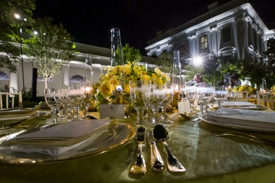 A table is set during a media preview for the State Dinner with President Donald Trump and Australian Prime Minister Scott Morrison in the Rose Garden of the White House, Thursday, Sept. 19, 2019.