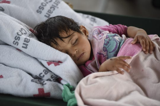 Ten-month-old Xitlaly Solomon sleeps in a temporary shelter, Tuesday, June 25, 2019, in Deming, New Mexico. Solomon traveled from Honduras with her father and is seeking asylum.