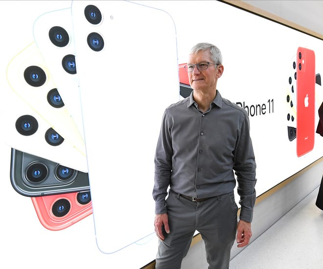 CEO Tim Cook greets shoppers inside the store.