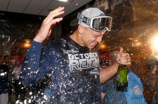 September 19: Aaron Judge celebrates in the Yankees locker room.
