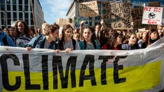 Protesters march through Brussels with placards as they take part in a Global Climate Strike demonstration on September 20, 2019 in Brussels, Belgium. Millions of people join protests around the world today to mark the start of a week of global climate strikes, with activists calling on their Governments to urgently address the climate crisis.
