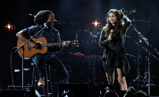 """Toni Cornell, daughter of the late singer Chris Cornell, performing with Ziggy Marley during """"I Am the Highway: A Tribute to Chris Cornell"""" in Inglewood, Calif., on Jan. 16, 2019. A ballad that Cornell produced for his daughter Toni when she was just 12 is now being released. """"Far Away Places"""" was written by Toni three years ago and was one of the last songs Cornell recorded before his death in May 2017."""