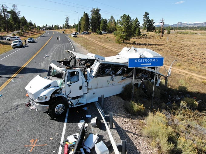 Troopers from the Utah Highway Patrol investigate a fatal bus crash near Bryce Canyon National Park on Friday, Sept. 20, 2019.