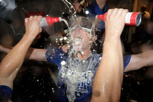 The Los Angeles Dodgers, which beat strategist Brant Brown, is bathed during a locker room celebration after the Dodgers defeated the Baltimore Orioles 7-3 at a baseball game on Tuesday, September 10, 2019 in Baltimore. . The Dodgers have won the NL West title. (AP Photo / Julio Cortez) ORG XMIT: BAB20