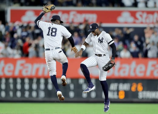 September 19: Didi Gregorius, left, and Cameron Maybin celebrate in the field.