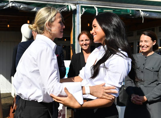 Duchess Meghan of Sussex embraces her friend, designer Misha Nonoo, as she launched her Smart Works fashion capsule collection on Sept. 12, 2019 in London.