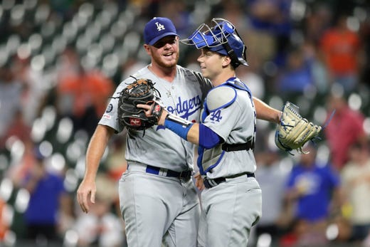 Los Angeles relief pitcher Dodgers Caleb Ferguson on the left and catcher Will Smith react after the decisive victory.