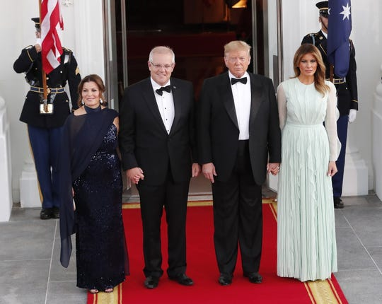 President Donald Trump and first lady Melania Trump welcome Prime Minister of Australia Scott Morrison and his wife, Jenny Morrison at the North Portico of the White House for a state dinner, Sept. 20, 2019.