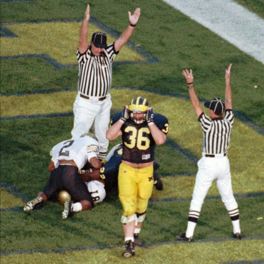 Colorado's James Kidd (2) celebrates with teammate Michael Westbrook (81) after Westbrook scored on a 64-yard game-winning touchdown pass on the final play against Michigan on Sept. 24, 1994.