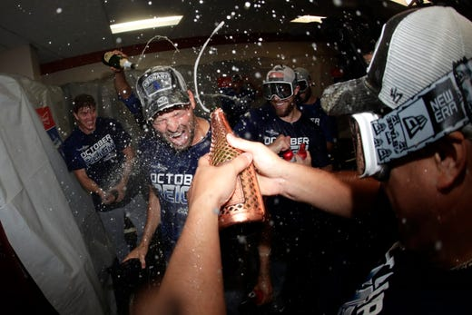 Los Angeles Dodgers pitcher Rich Hill sits downtown during a locker room celebration after beating the Baltimore Orioles 7-3 during a baseball game Tuesday, September 10, 2019 in Baltimore. The Dodgers won the National League West Division title with the victory. (AP Photo / Julio Cortez) ORG XMIT: BAB20