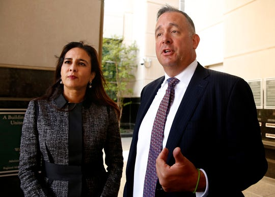 Attorney's Harmeet Dhillon, left , and Justin Clark, right, who represented the California and national Republican parties, discuss the tentative ruling by a federal judge to halt a California law that's aimed at forcing the president to release his tax returns, in Sacramento, California, Thursday, Sept. 19, 2019. U.S.District Judge Morrison England Jr. will issue a formal ruling by Oct. 1.