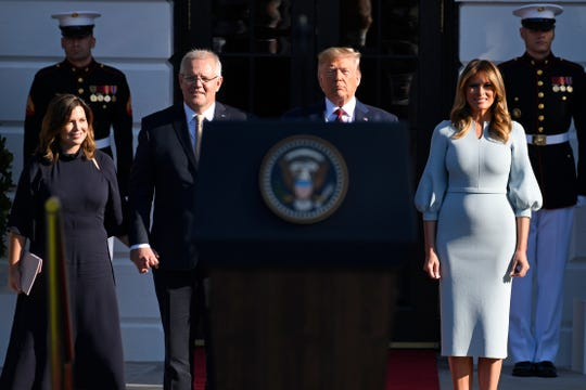 President Donald Trump and first lady Melania Trump welcome Australian Prime Minister Scott Morrison and his wife Jenny Morrison during a state arrival ceremony on the South Lawn of the White House, Sept. 20, 2019.