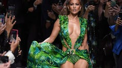 Jennifer Lopez presents a creation by Versace during the Milan Fashion Week, on September 20, 2019.