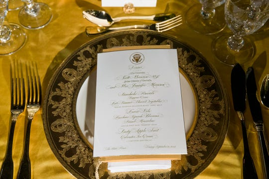 A table is set during a media preview for the State Dinner with President Donald Trump and Australian Prime Minister Scott Morrison in the Rose Garden of the White House, Thursday, Sept. 19, 2019, in Washington.