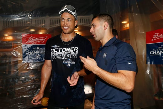 September 19: Giancarlo Stanton of New York is bathed in champagne.