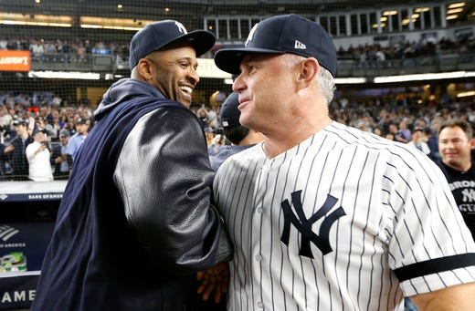 September 19: CC Sabathia and third baseman Phil Nevin celebrate in the field.