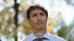 """Canada's Prime Minister Justin Trudeau addresses the media in Winnipeg, Manitoba, Thursday, Sept. 19, 2019. Trudeau's campaign was hit Wednesday by the publication of a yearbook photo showing him in brownface makeup at a 2001 costume party. The prime minister apologized and said """"it was a dumb thing to do."""" (Sean Kilpatrick/The Canadian Press via AP) ORG XMIT: SKP223"""