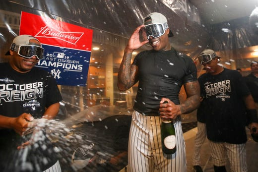 September 19: Yankees relief pitcher Aroldis Chapman celebrates when New York City wins its first American League title since 2012.
