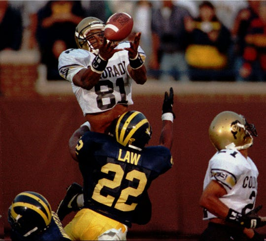 Colorado wide receiver Michael Westbrook reaches over Michigan defensive back to make the game-winning catch with no time left in Colorado's 27-26 win in on Sept. 24, 1994.
