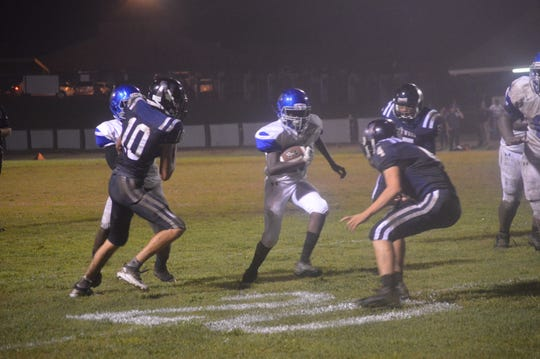 Bolton running back Aaron Obey carries the football late during the Bears' 58-0 win over Northwood Friday.