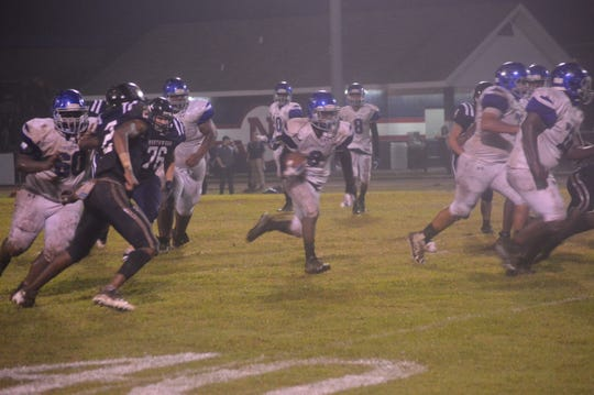 Bolton running back Delvrick Tatum (3) runs for a touchdown against Northwood Friday.
