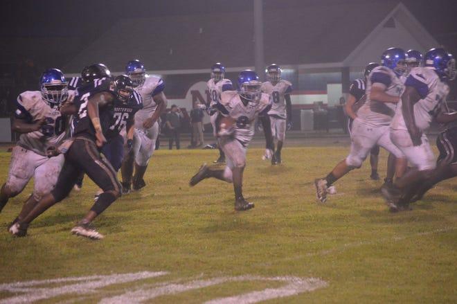 Bolton running back Delvrick Tatum (3) runs for a touchdown against Northwood Friday.