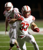 Kimberly High School's Caleb Frazer (33) runs for a touchdown to give his team a 35-28 lead in the fourth quarter against Appleton East High School during their football game Friday, September 20, 2019, in Appleton, Wis.Dan Powers/USA TODAY NETWORK-Wisconsin