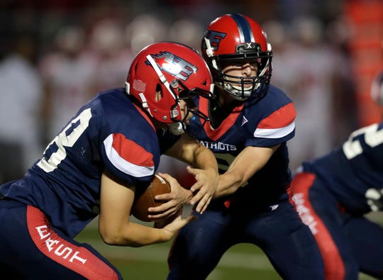 Appleton East High School's quarterback Bennett Petersen (9) hands off the ball to Nick Bouvat (48) against Kimberly High School during their football game Friday, September 20, 2019, in Appleton, Wis.Dan Powers/USA TODAY NETWORK-Wisconsin