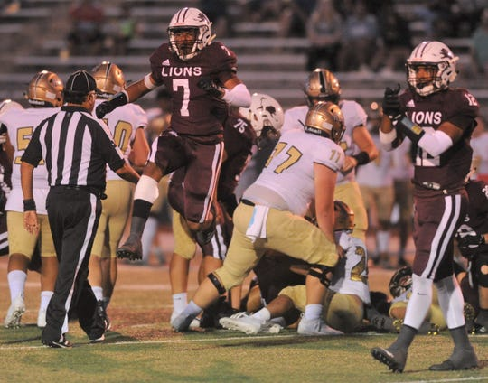 Brownwood defenders Royshad Henderson (7) and A.J. McCarty (12) celebrate a turnover on downs in the first quarter against Wichita Falls Rider on Friday, Sept. 20, 2019, at Gordon Wood Stadium in Brownwood.
