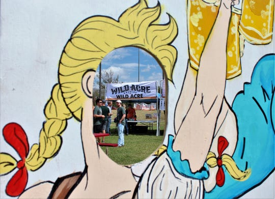 Abilene Beer Summit attendees could pose for photos at a cutout surrounded by dozens of vendors such Wild Acre Brewing Company on Saturday at Frontier Texas!