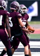 McMurry running back De'Marea Robinson celebrates his touchdown during the first half of the War Hawks football game against Sul Ross.