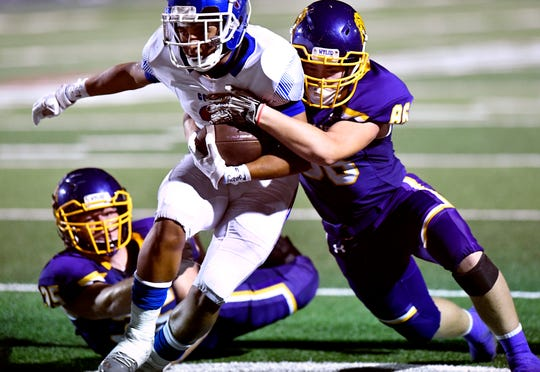 Cooper running back Noah Garcia is tackled by Wylie linebackers Riley Hood (right) and Dax Morris during Friday's Southtown Showdown football game between Cooper and Wylie high schools at Shotwell Sept. 20, 2019. Final score was 30-0, Cooper.