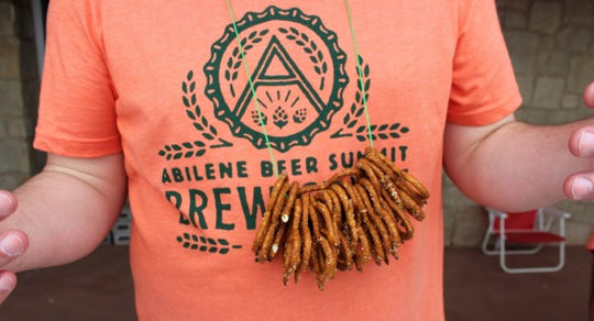 In some parts of the country, nothing goes better with beer than pretzels, and pretzel necklaces are worn. The ingredients of each balance the other, it is said. It's not known if beer necklaces are worn at pretzel events. The annual Abilene Beer Summit was Saturday at Frontier Texas!