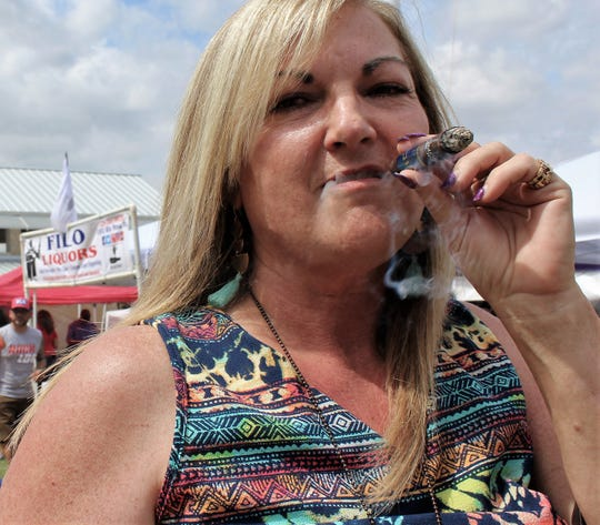 """Liz Campbell, of Coleman, said she smokes a cigar once a year, usually to celebrate her marriage to Jerry. She was the only woman seen smoking a serious stogie at Saturday's Abilene Beer Summit. They have reached 39 years of wedded bliss. She picked a sweet flavored cigar; Jerry was going to light up """"in a little while,"""" he said. Their anniversary is Dec. 26."""