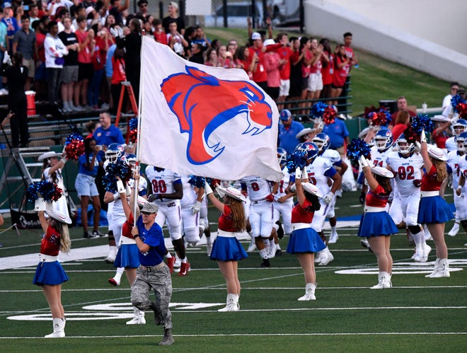 The Cooper High School Cougars take the field at Shotwell Stadium during the Southtown Showdown with the Wylie Bulldogs on Sept. 20. Abilene Cooper hosts El Paso Del Valle Friday in a first-round football playoff game. The Coogs are 10-7-1 all-time in home playoff games.