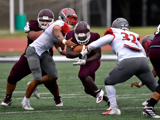 War Hawk running back Kameron Session breaks through the Sul Ross University defense during McMurry University's football game Saturday against the Lobos. McMurry lost 21-7.