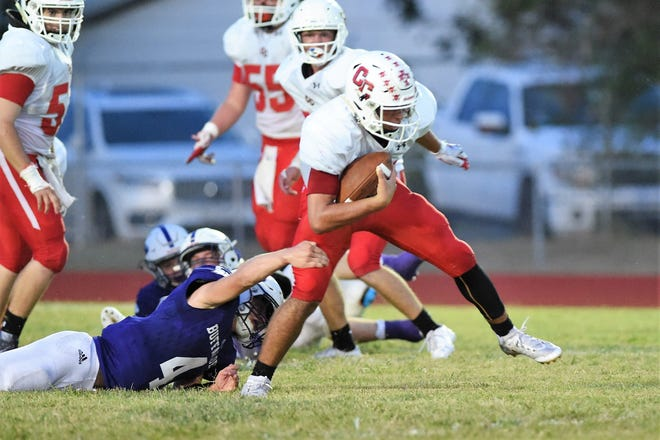 Christoval's Brayden Wilcox (10) tries to break a Cross Plains tackle at Buffalo Stadium on Friday, Sept. 20, 2019.