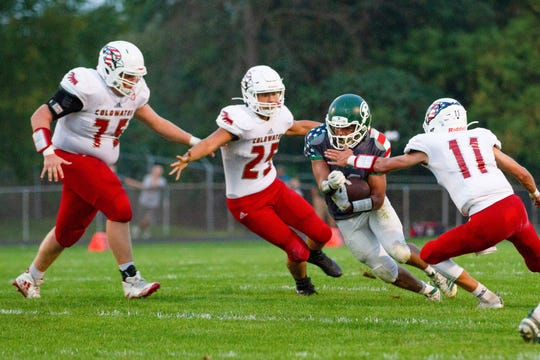 Pennfield running back Cody Haltink is surrounded by Coldwater defenders on Friday, Sept. 20, 2019.