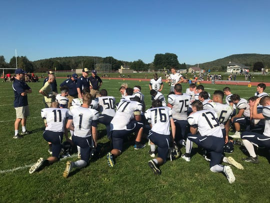 Coach Mike Ford has a chat with the boys following SV's 58-21 win at Newark Valley.