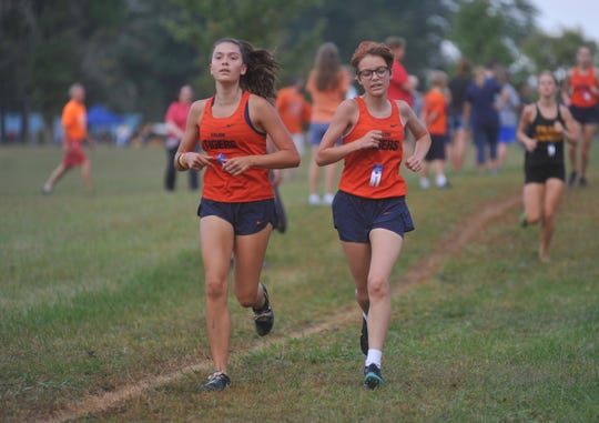 Galion's Zaynah Tate and Brooklyn Gates run alongside each other at the Crawford County Meet.